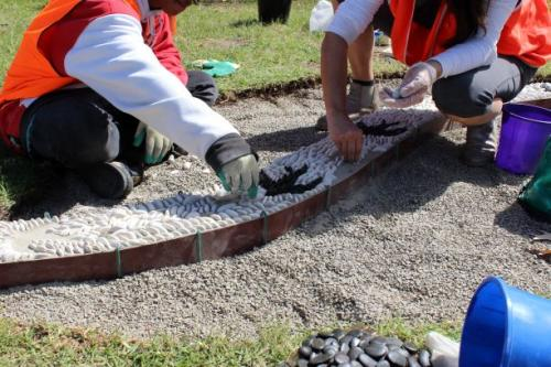 Two young people laying peddles into a mosaic for a project in Barwon South west Region