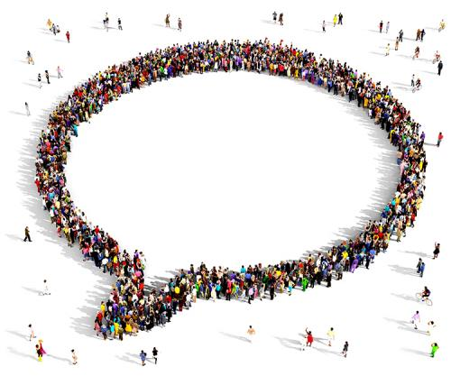 A shape of a speech bubble formed by many people